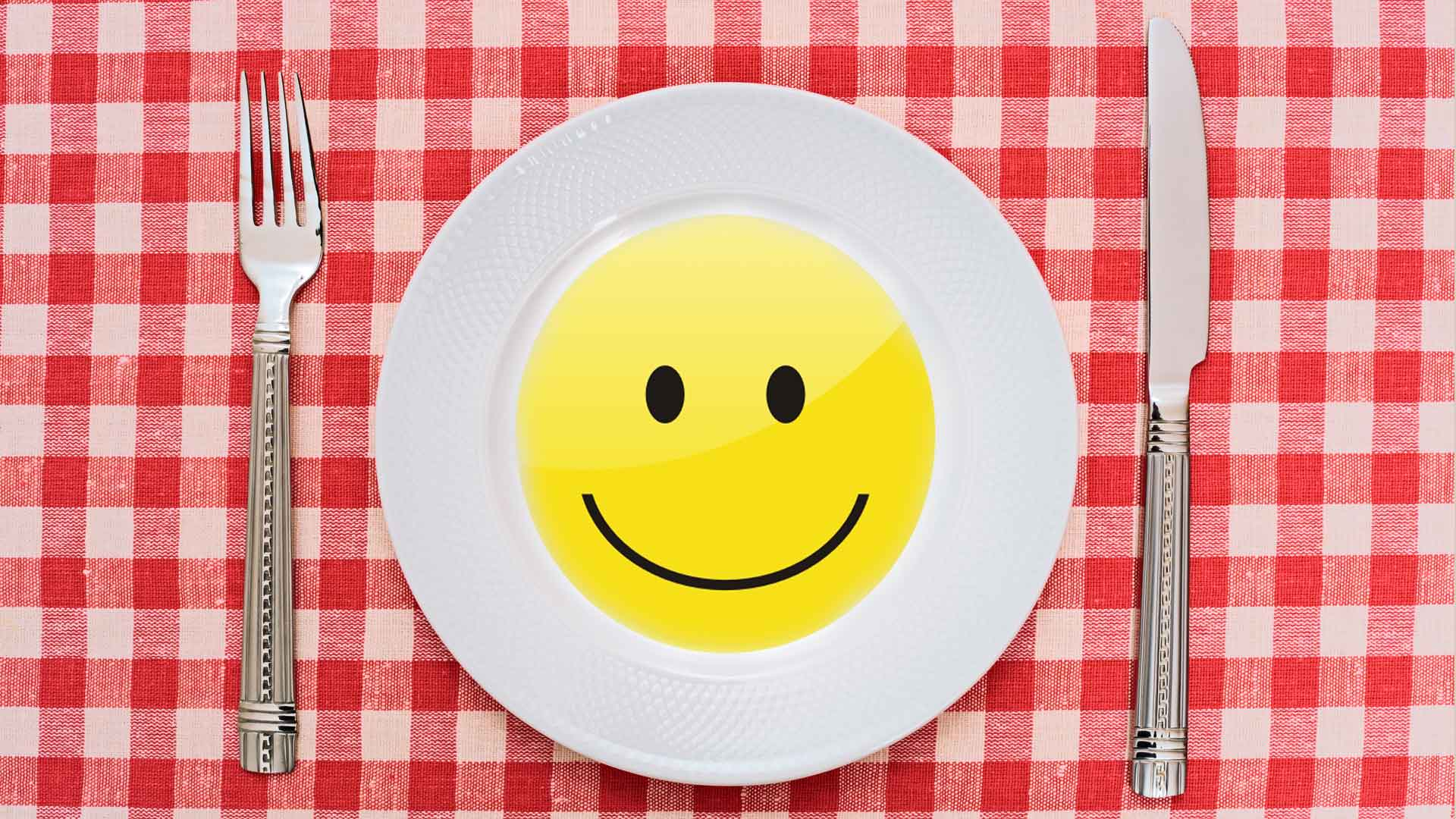 learning and development at lunchtime - smiling plate on dinner cloth