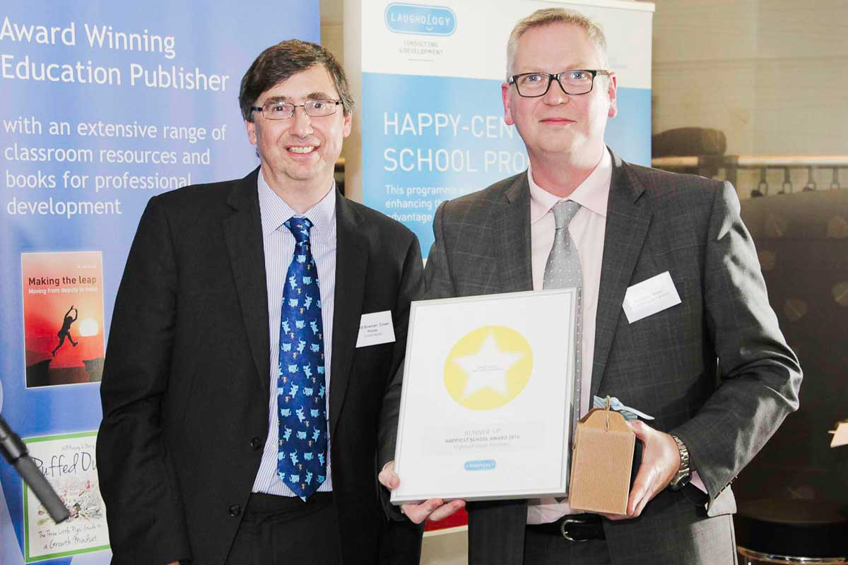 Highfield South Farnham celebrates third place in the Happiest School category Headteacher Gregory West receives the award