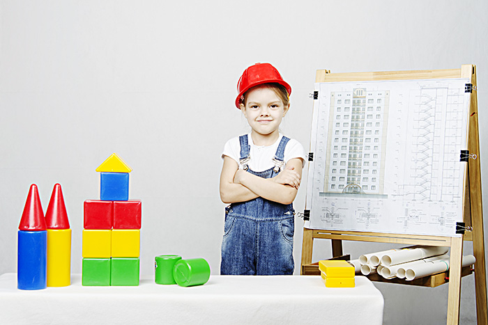 young girls dressed up as a builder